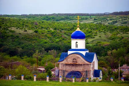 Blue dome of christian church with golden cross. Religious symbol of the Russian Orthodox Church. 版權商用圖片