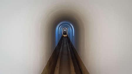 Narrow long white surreal tunnel as tube. 版權商用圖片