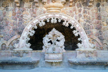 Ancient drinking fountain in neo-Gothic style in a public park in Sintra, Portugal, October 04, 2018.