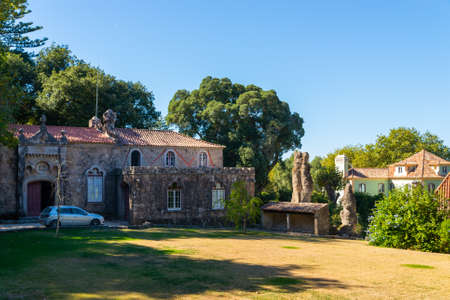 Portugal, Sintra, October 07, 2018: The car is parked next to a wonderful stone house. 新聞圖片