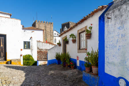 Obidos, Portugal - October 05, 2018: Architectural detail of small houses typical of the historic city center.