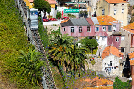 Guindais Funicular or Funicular dos Guindais and picturesque houses in historic center of Porto city, Portugal, October 06, 2018. 新聞圖片