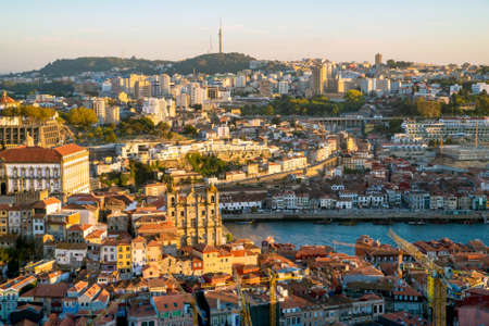Aerial view of Porto Cityscape, Portugal. One of the oldest European centers with traditional orange roof tiles. Its historical core was proclaimed a World Heritage Site by UNESCO.