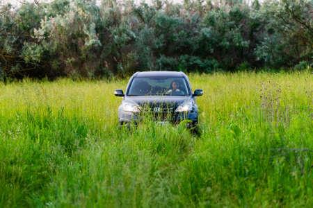 Russia, Rostovskaya oblast - June 10, 2020: SUV Honda CRV 4x4, black color in wild nature. Travel and adventure concept.