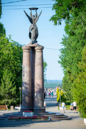 TAGANROG, RUSSIA - June 24, 2020: Monument to commemorate the 300th anniversary of the city. It was unveiled on September 13, 2002. The sculpture of angel by David Begalov was installed in 2009.