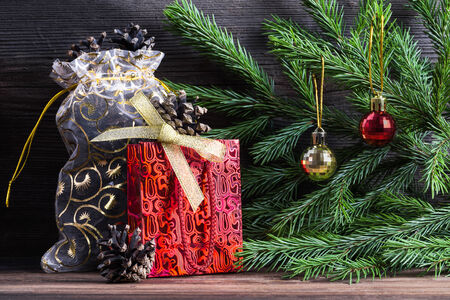 Composition with Christmas decorations. Fir tree cones, balls, ribbon. photo