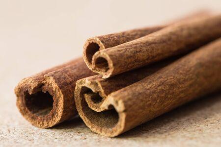 corkwood: Сinnamon sticks on corkwood background, close-up shot