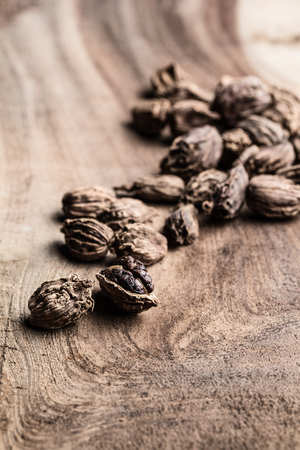 Black cardamom on wooden background with copy space 写真素材