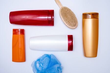 A set of shower products in colorful plastic bottles, sponge and massage brush for bodycare on white background. 스톡 콘텐츠