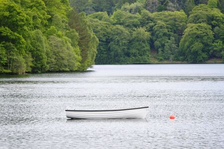 A lone boat on a lake in Scotland, England. Stock Photo