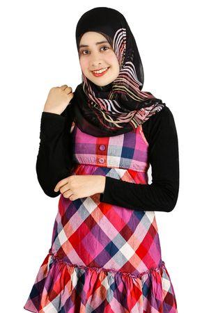 mujeres musulmanas: Un joven musulm�n que muestra una mujer musulmana moderna moda Foto de archivo