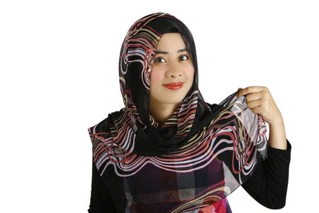 A young muslim women putting on headscarf Stock Photo