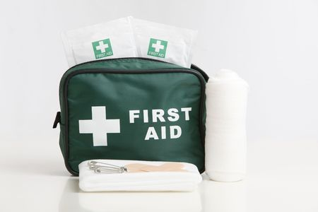 First Aid kit with bandage, plasters,and wipes isolated on a white background.
