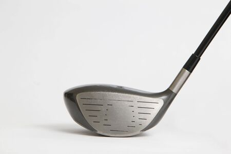 A fairly used golf driver isolated on a white background. Stock Photo