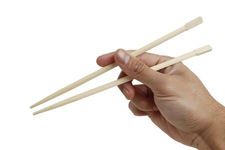 A hand holding a chopstick isolated on white with clipping path. easy to extract.