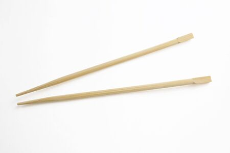 A wooden chopstick isolated on white with clipping path. easy to extract.