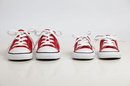 Red Shoes isolated on white. Big Brother - Concept
