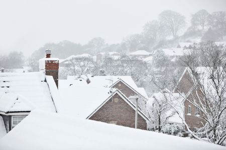 Snow covered rooftops on a cold winter day Stock Photo