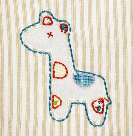 Patchwork design of a giraffe on a blanket