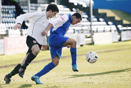 PORT TALBOT, WALES - FEBRUARY 20: Drew Fahiya (right) of Port Talbot and Martyn Beattie (left) of Welshpool in action during their Welsh Premier League match February 20, 2010 in Port Talbot, Wales. Stock Photo - 6890173