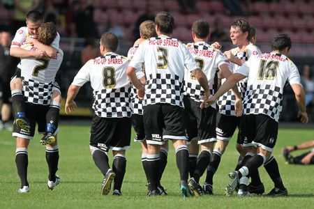 NEATH, WALES - SEPTEMBER 13: Neath players celebrate their winning goal during their Welsh Premier League match against Bala Town at The Gnoll Stadium September 13, 2009 in Neath, Wales. Neath won 2-1 Editorial