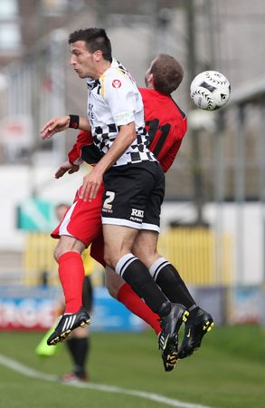 NEATH, WALES - SEPTEMBER 13: Carlos Castan (left) of Neath and Osian Jones (right) of Bala Town in action during their Welsh Premier League match September 13, 2009 in Neath, Wales. Neath won 2-1
