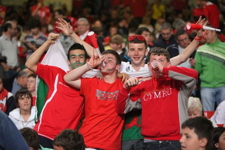 CARDIFF, WALES - SEPTEMBER 9: Wales football fans at The Millennium Stadium during the 2010 World Cup Qualifier match between Wales and Russia, September 9, 2009.