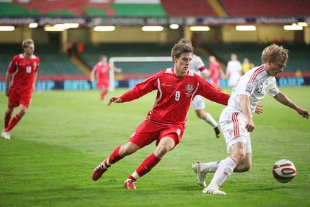 CARDIFF, WALES - SEPTEMBER 9: Aaron Ramsey (left) of Wales and Alexei Rebko (right) of Russia fights for the ball during their 2010 World Cup Qualifiying match against Wales at The Millennium Stadium, Cardiff. Russia won 3-1. Stock Photo - 6896998