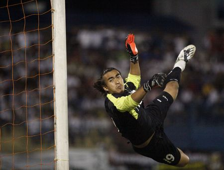 TERENGGANU, MALAYSIA - JANUARY 30: Kuala Lumpur goal keeper Remezey Che Ros attempts a save during their Malaysian Super League match against Terengganu January 30, 2010 in Terengganu, Malaysia
