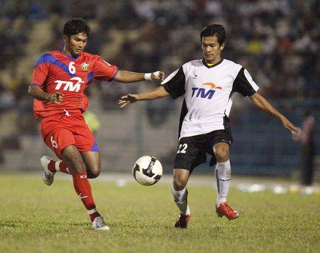TERENGGANU, MALAYSIA - JANUARY 30: Terengganu Ashaari Shamsuddin (right) and Kuala Lumpur Jeremy Denker (left) in action during their Malaysian Super League match January 30, 2010 in Terengganu, Malaysia