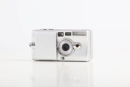 Compact film camera isolated on white background