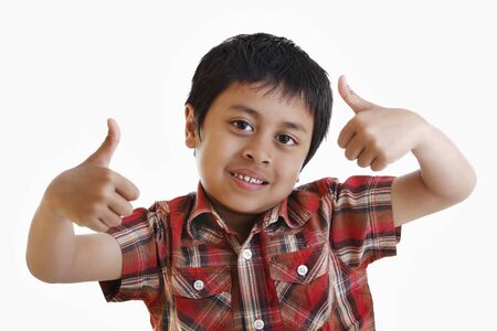 A young asian boy giving a thumbs up Stock Photo