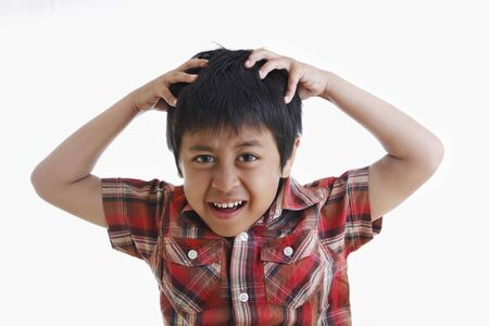 A young asian boy showing his frustration Standard-Bild