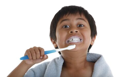 A young boy brushing his teeth