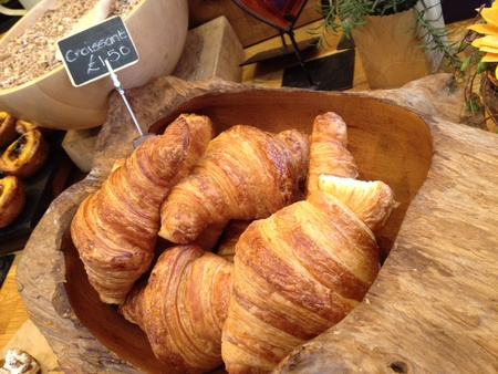 Croissants in a wooden bowl display
