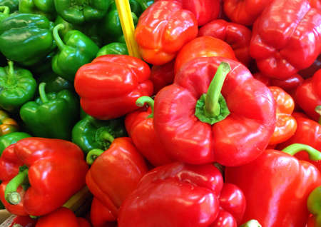 Red and green capsicums on display at the market Stock Photo