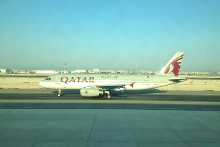 A Qatar Airways aircraft taxiing into the runaway at the Qatar International Airport