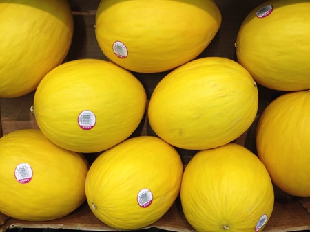 Honeydew melons on sale at the local supermarket Stock Photo