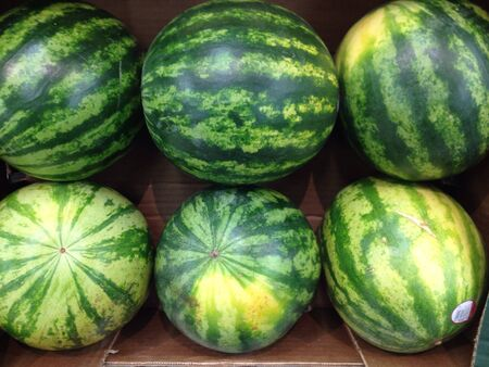 Watermelons on sale at the local supermarket Stock Photo