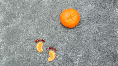 Delicious juicy ripe fragrant tangerines on gray background