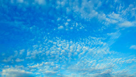 Beautiful aerial sky with big cute romantic blue clouds