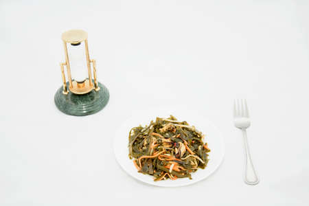 Seaweed with pickled mussels in a white plate 免版税图像
