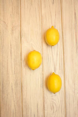 Juicy ripe delicious lemon on a light background