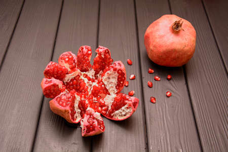 Beautiful juicy pomegranate in a cut on a light background