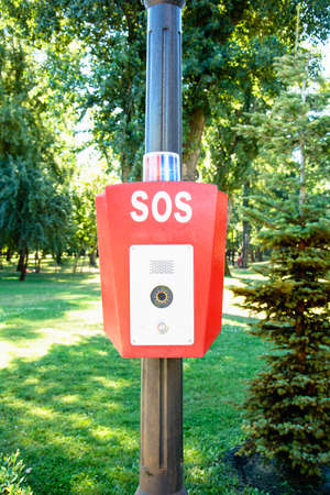 Signal button in the park to call the police