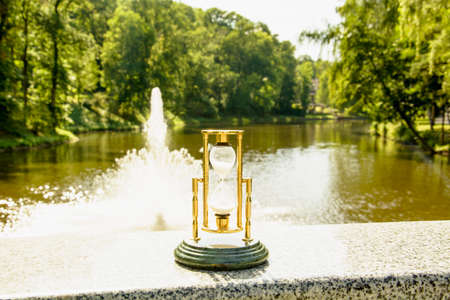 Beautiful hourglass stand against the background of beautiful nature