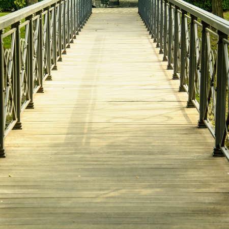 Big beautiful wooden road in a beautiful park Фото со стока