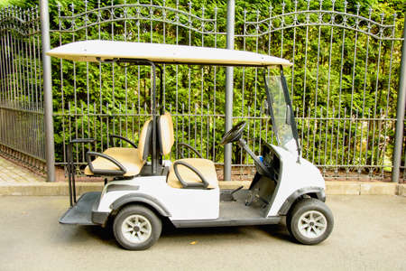 Small electric golf car in the parking lot
