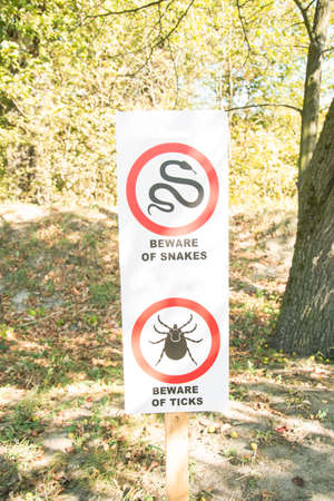 Information board about poisonous snakes and tick beetles