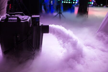 Dry ice low fog machine with hands on for wedding first dance in restaurants 스톡 콘텐츠